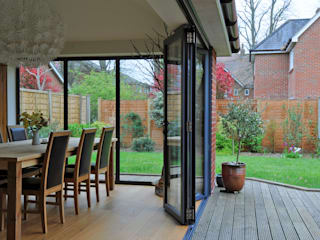 Bi folding door and fixed aluminum windows Modern Windows and Doors by ROCOCO Modern