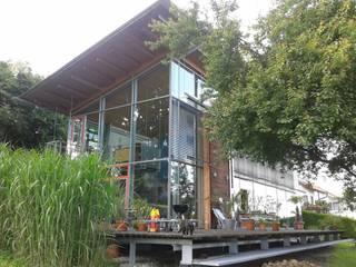 Südseite mit Terrasse 2:  Garten von Kaufmann Freie Architekten