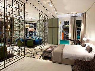 Stand para Güell Lamadrid Hoteles de estilo ecléctico de DyD Interiorismo - Chelo Alcañíz Ecléctico