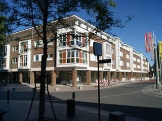Wohn- und Geschäftshaus am Bahnhof Moderne Häuser von Architekturbüro Wördemann Modern