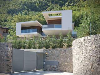 vista dall'accesso stradale: Case in stile  di STUDIO ARCHITETTURA MASSIMO NODARI