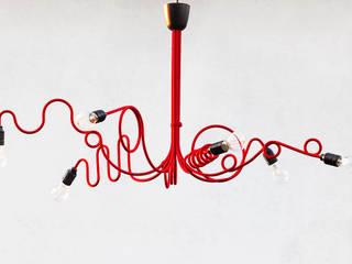 Chaos Czerwony: styl , w kategorii Salon zaprojektowany przez Profizorka