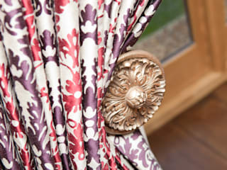Ornate tie back and rich curtain fabric:   by Design by Deborah Ltd