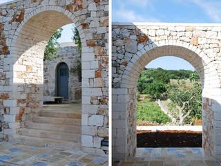 Casa per vacanze in Puglia: Case in stile  di PAOLA REBELLATO ARCHITETTO