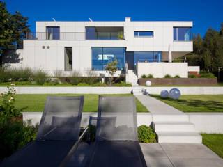 Gartenansicht:  Häuser von Knychalla + Team, Architekten, Stadtplaner GmbH
