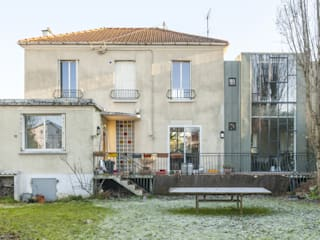 Vue du jardin: Maisons de style de style Moderne par maéma architectes