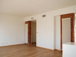 Ristrutturazione appartamento Milano Via Bazzini: Soggiorno in stile  di Studio Baiardi SaS  di Arch. Mauro Baiardi & C.