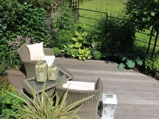 Small contemporary boutique garden:   by Dawn Garden Design