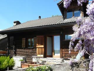 Casa vacanze in Svizzera Case in stile rustico di Interni d' Architettura Rustico