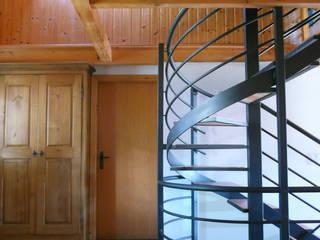 Casa vacanze in Svizzera Ingresso, Corridoio & Scale in stile rustico di Interni d' Architettura Rustico