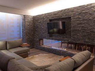 Departamento DL Salones modernos de kababie arquitectos Moderno
