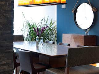 Comedores de estilo moderno por kababie arquitectos