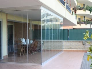 Pareti in vetro: Case in stile  di WEESE