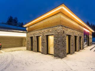 Naturstein, Glas, Holz - eine stimmige Kombination Moderne Häuser von Jahn Gewölbebau Modern