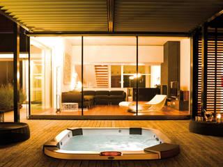 Maxi Spa Santorini PRO designed for Jacuzzi:  in stile  di DNA |design by Kaluderovic & Condini|
