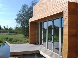 Suarlée I Extension d'habitation I Ossature bois I 2009 Maisons modernes par SECHEHAYE Architecture et Design Moderne