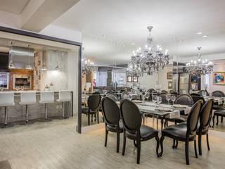 Apartamento em Cascavel: Salas de jantar  por Evviva Bertolini