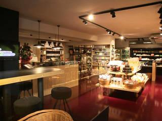 Oficinas y Tiendas de estilo  por Miriam Barrio