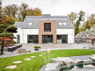 Maisons de style  par ONE!CONTACT - Planungsbüro GmbH