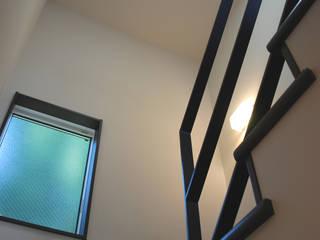 学園西町の家: 奥村召司+空間設計社が手掛けた廊下 & 玄関です。,