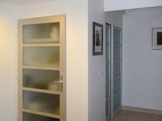 Rénovation d'un appartement de 86m² au Puy-en-Velay Salle à manger moderne par BOURDELAIN Chloe Moderne
