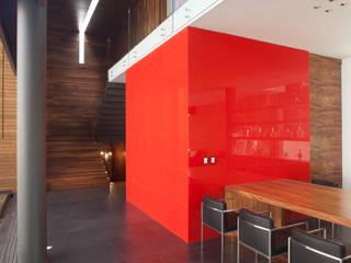 Sala da pranzo minimalista di Echauri Morales Arquitectos Minimalista