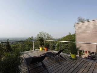 Réalisation d'une maison à ossature Bois Maisons modernes par Inside Home Concept Moderne