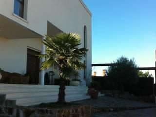 Chalet en urbanización del norte de Madrid Casas de estilo mediterráneo de Proyectos Carmona Mediterráneo