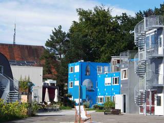 Container Uni – So viel Garage war nie! Ausgefallene Schulen von quartier vier Architekten Landschaftsarchitekten Ausgefallen