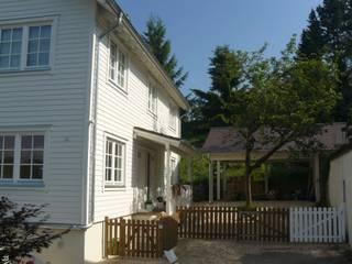 """Biohaus """"Virginia"""" - das Holzhaus im amerikanischen Stil:  Häuser von Skan-Hus Projekt GmbH"""