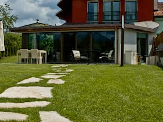 CASA TESSER: Case in stile  di Studio di Architettura Fabiola De Battista Nicola Collazuol - Atelier 2IN1