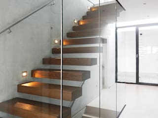 Modern Corridor, Hallway and Staircase by unlimited architekten | neumann + rodriguez Modern