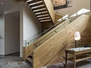 Paredes y pisos de estilo rústico de PAUMATS S.L. Rústico