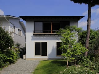 Maisons originales par 早田雄次郎建築設計事務所/Yujiro Hayata Architect & Associates Éclectique