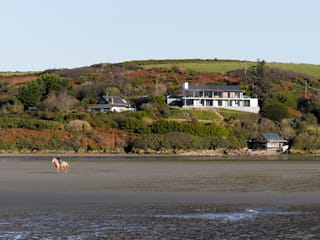 View from across estuary:   by John Pardey Architects