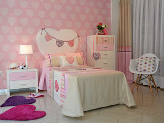 Un dormitorio para niñas en rosa y con corazón de Villalba Interiorismo Moderno