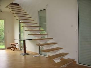 Extension Maison à Sucé-Sur-Erdre Salon minimaliste par SERAIN-LOUKAKOU ARCHITECTEURS Minimaliste