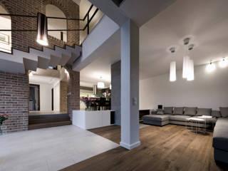 Dom jednorodzinny w Szczecinie Nowoczesny salon od Pracownia Świętego Józefa Nowoczesny