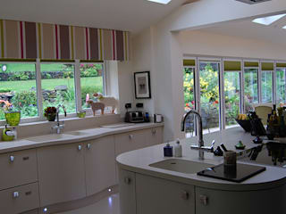 Bi-fold doors:  Kitchen by Nest Kitchens