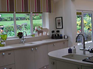 Corian worktops:  Kitchen by Nest Kitchens