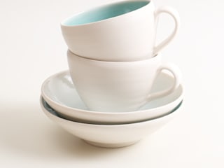 Handmade porcelain cups and saucers:   by Linda Bloomfield