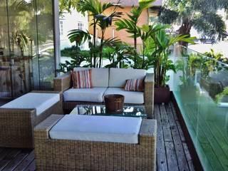 Terrace by Kika Prata Arquitetura e Interiores., Tropical