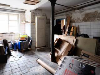 Kernsanierung von Garage zu Büro:   von Fischer Raumgestaltung