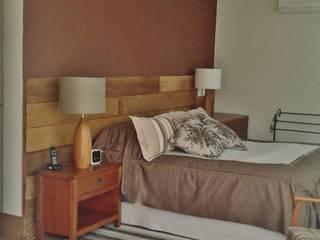 Dormitorios rústicos de Kika Prata Arquitetura e Interiores. Rústico