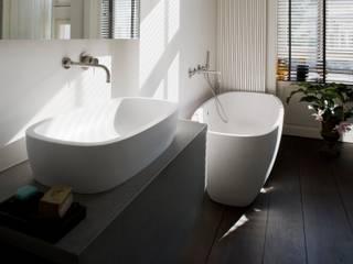 Baños de estilo  por Schmidt Holzinger Innenarchitekten , Moderno