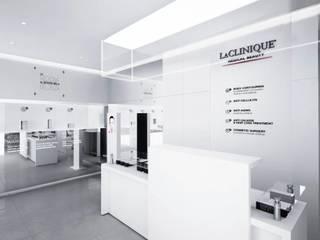 Franchising format LaCLINIQUE 2014 Spazi commerciali moderni di Un-real Studio Associato Moderno