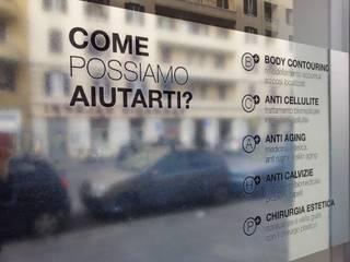 Franchising LaCLINIQUE Roma Spazi commerciali moderni di Un-real Studio Associato Moderno