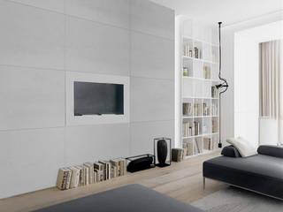Płyty z jasnego betonu architektonicznego - siwa biel Nowoczesny salon od Luxum Nowoczesny