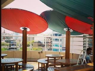 Diseno de bar comercial Bares y clubs de estilo tropical de rl.decoarq Tropical