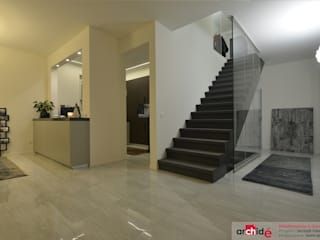 Modern corridor, hallway & stairs by Archidé SA interior design Modern